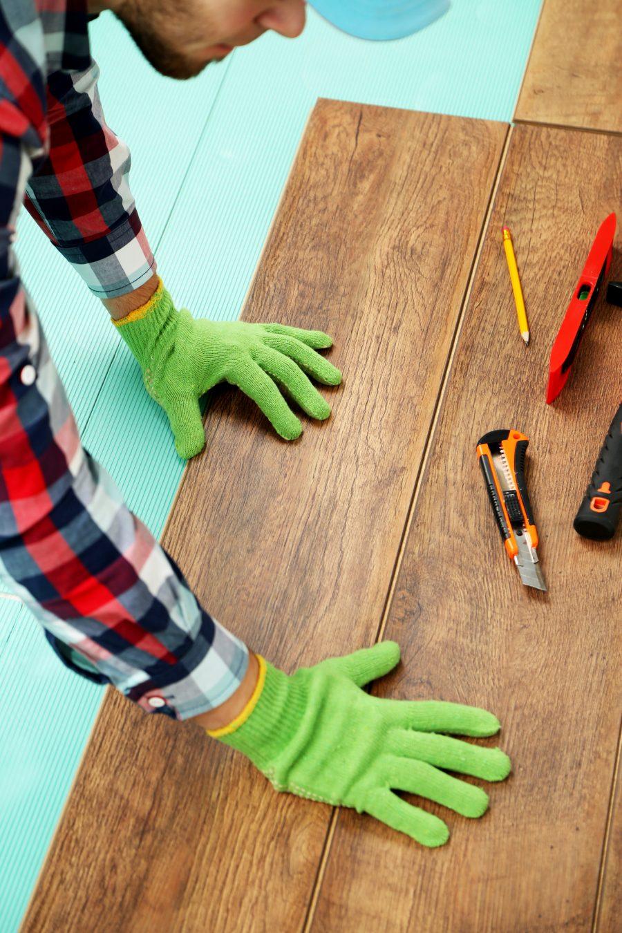 contractor installing wood flooring.