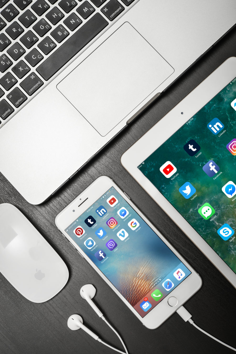 Flat lay of smartphone, tablet and laptop