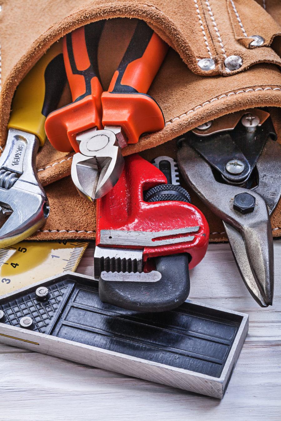 tool belt full of plumbing tools. DIY Plumbing