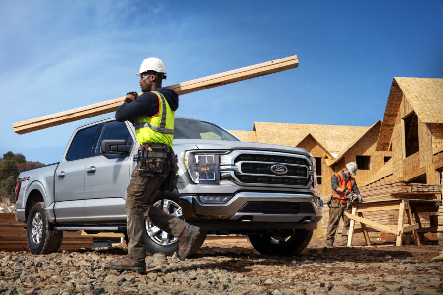 contractor hauling lumber at a construction site, using a F-150 - Built ford Tough