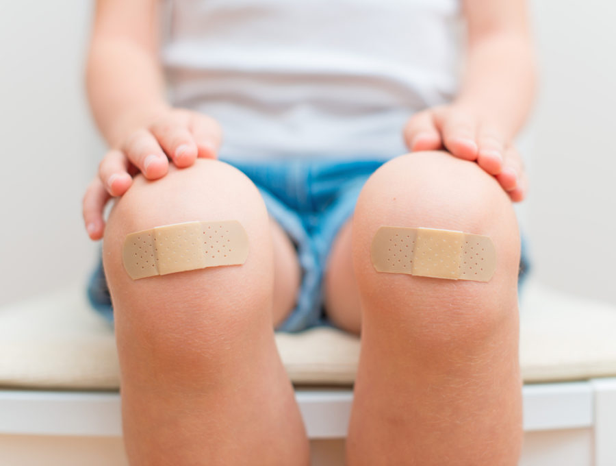 Child knees with bandage