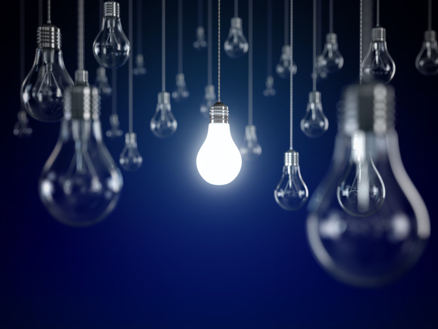 50 light bulbs hanging from wire, with one bulb lit.  how to become an electrician apprentice