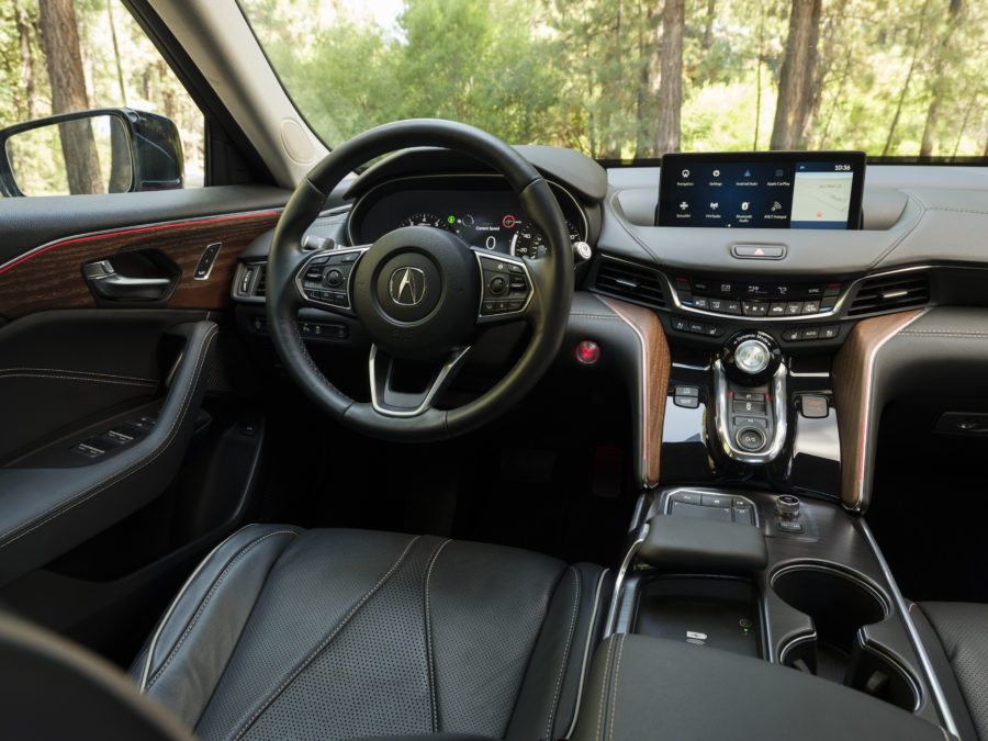 the interior of the 2021 TLX Advance, black with accents of red