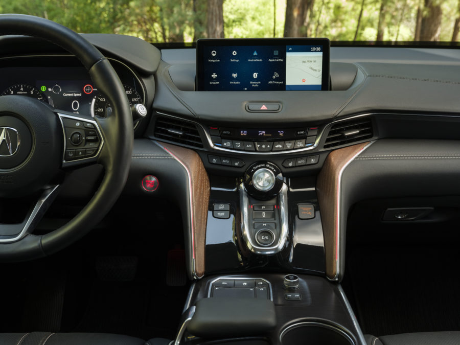 the interior console of the 2021 TLX Advance, black with accents of red