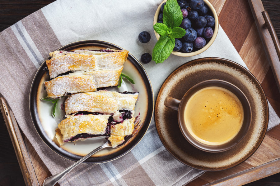 Homemade mixed berry strudel, on wooden tray