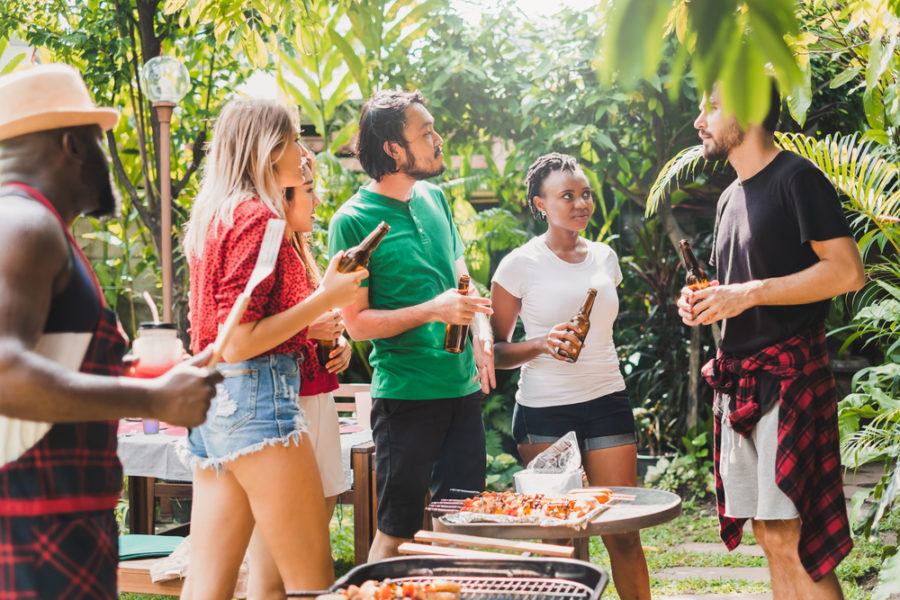 Group of diversity people having barbecue/barbeque party at home