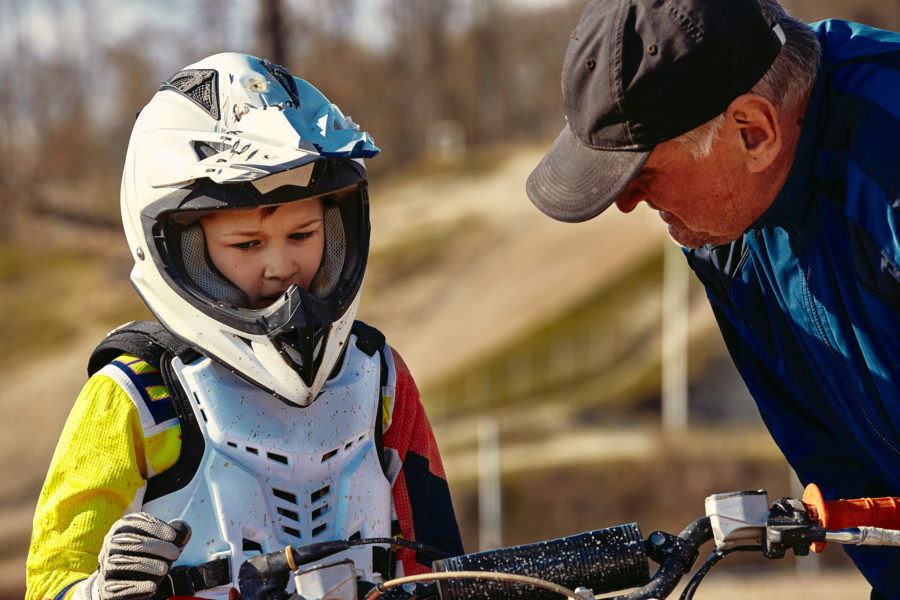young motocross rider receiving advice about dirt bike accidents
