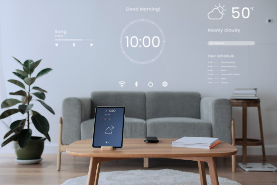 Digital tablet screen with smart home controller on a wooden table