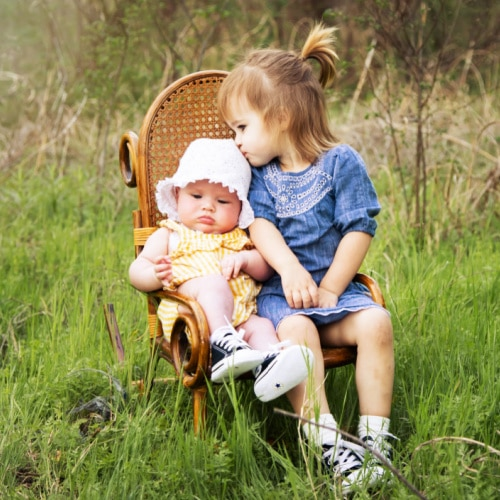 granddaughters sharing a rocking chair copy